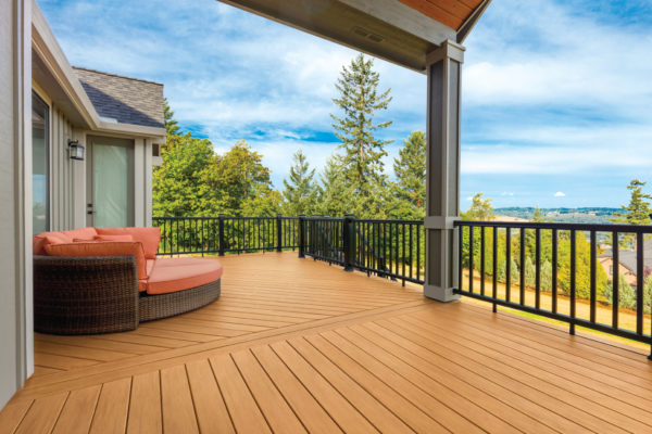Upper story deck made with TimberTech Edge Prime Coconut Husk Decking with scenic suburban background