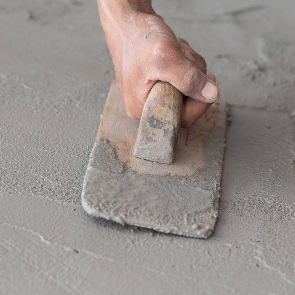 Person Troweling Concrete